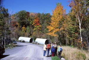 """Photo of """"new"""" culverts prior to installation on Bedford Rd. (circa 1987)"""